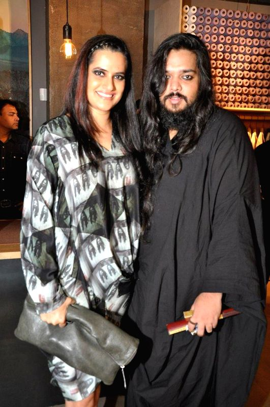 Singer Sona Mohapatra with fashion designer Kallol Datta during the preview and launch of Khadi Collection by Levis, in Mumbai, on Aug. 26, 2014.