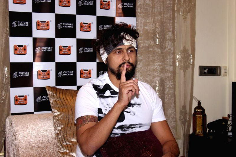 Singer Sonu Nigam talks about his recently social experiment - roadside Ustaad, in Mumbai on May 23, 2016. - Sonu Nigam