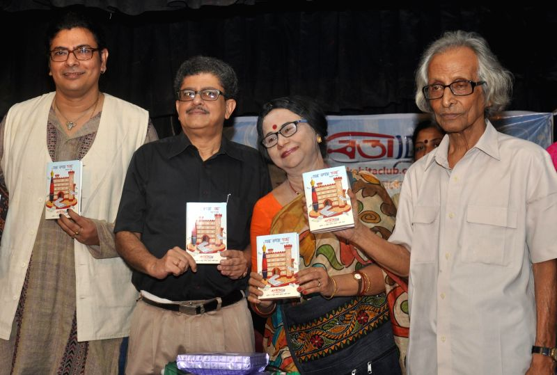Singer Surojit Chatterjee, Tridib Chattopadhyay, poet Krishna Basu and novelist Sanjib Chattopadhyay during launch of ` Alpo Kathay Goppo` - a book, in Kolkata on Aug 3, 2014. - Surojit Chatterjee and Basu