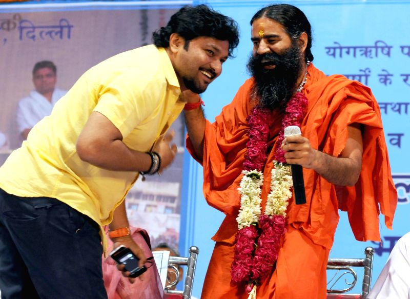 Singer turned politician Babul Supriyo who won Asansol Lok Sabha seat of West Bengal with Yoga guru Ramdev during Sankalp Purty Mahotsav organised by Bharat Swabhiman Trust in New Delhi on May 18, ...
