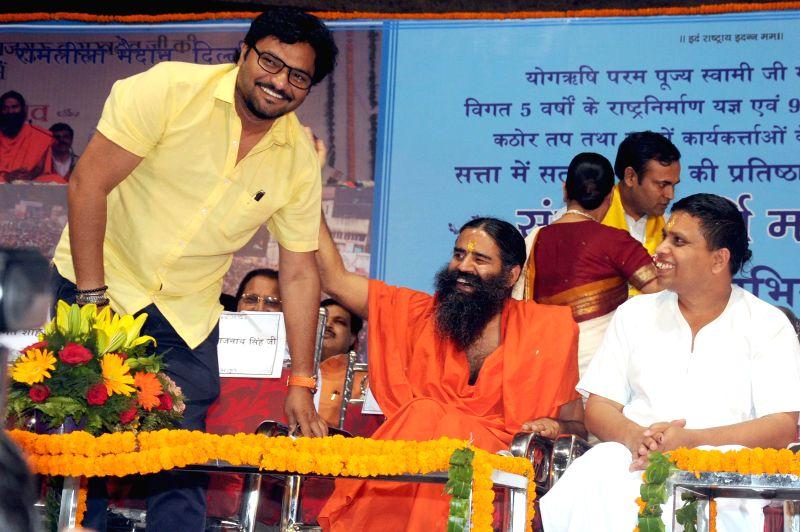 Singer turned politician Babul Supriyo who won Asansol Lok Sabha seat of West Bengal with Yoga guru Ramdev during Sankalp Purty Mahotsav organised by Bharat Swabhiman Trust in New Delhi on May 18, ...