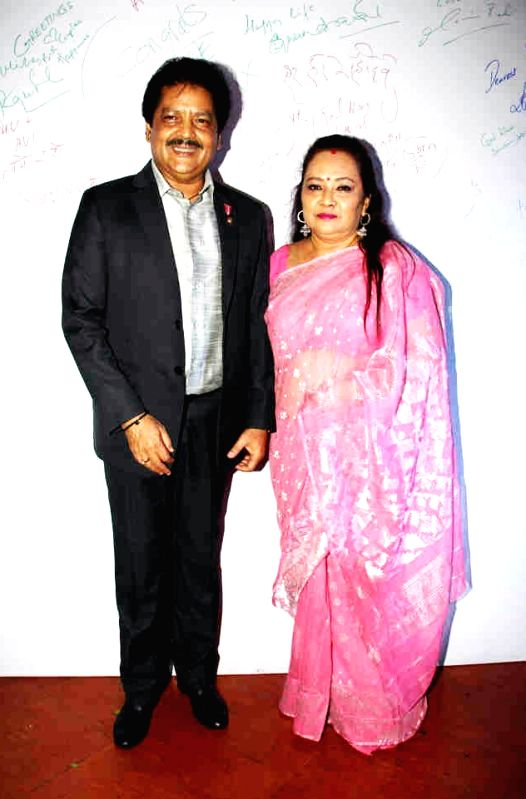 Singer Udit Narayan with his wife at the post wedding celebrations of Sambhavna and Avinash in Mumbai on July 28, 2016.