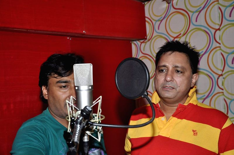Singers Anjjan and Sukhwinder Singh during the song recording for the upcoming film Rab Mujhe Pyaar Ho Gaya in Mumbai on June 18, 2014. - Sukhwinder Singh