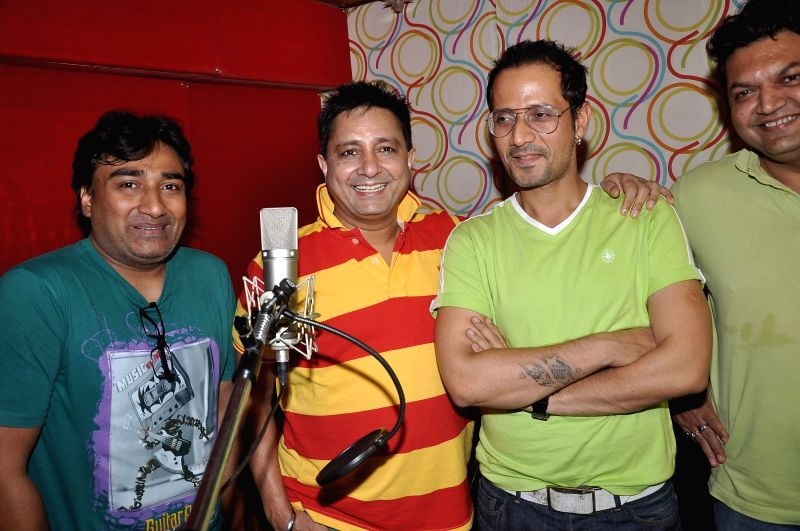Singers Anjjan, Sukhwinder Singh and Harmeet Singh during the song recording for the upcoming film Rab Mujhe Pyaar Ho Gaya in Mumbai on June 18, 2014. - Sukhwinder Singh and Harmeet Singh