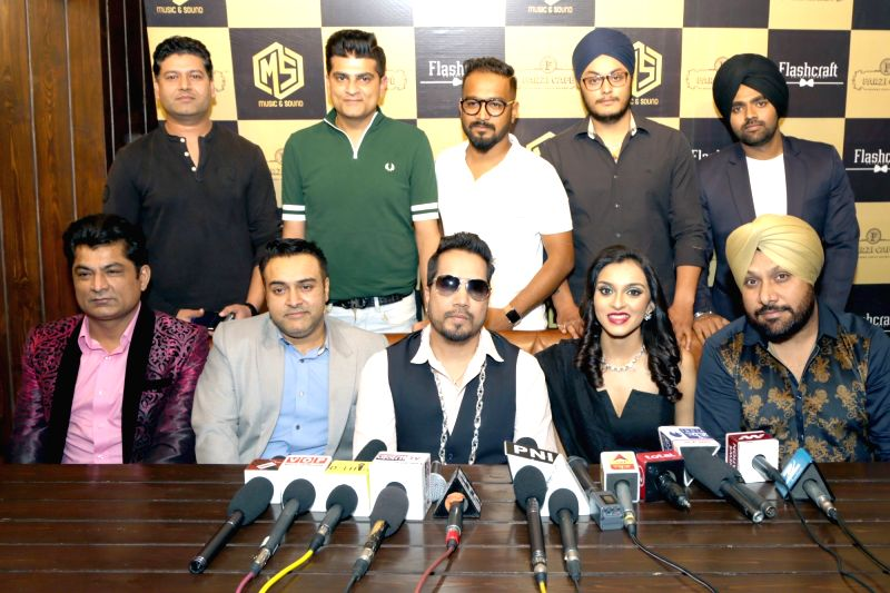 "Singers Mika Singh and Kirti Arneja at the launch of new music album ""Jogi"" in New Delhi, on April 28, 2017. - Mika Singh"