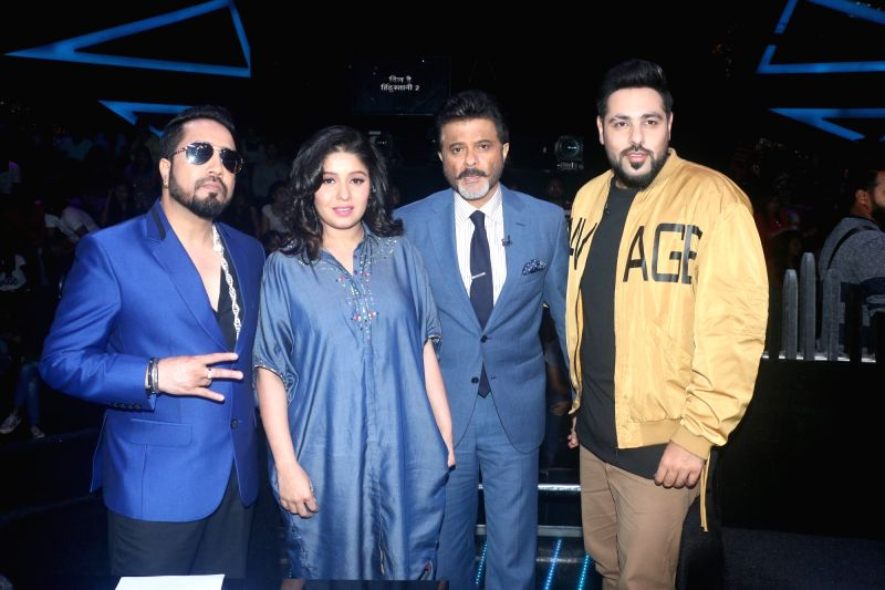 "Singers Mika Singh, Sunidhi Chauhan, actor Anil Kapoor and rapper Badshah on the sets of reality television show ""Dance Deewane"" in Mumbai on July 23, 2018. - Anil Kapoor, Mika Singh and Sunidhi Chauhan"