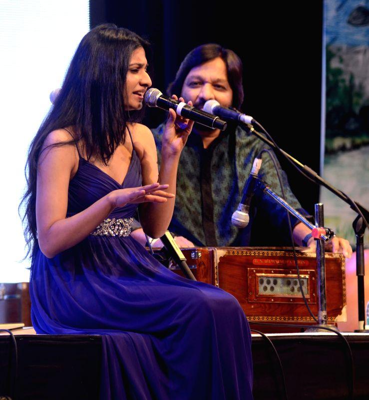 Singers Roop Kumar Rathod and Reewa Rathod perform during `Rain Raga` in Mumbai on June 29, 2014. - Roop Kumar Rathod