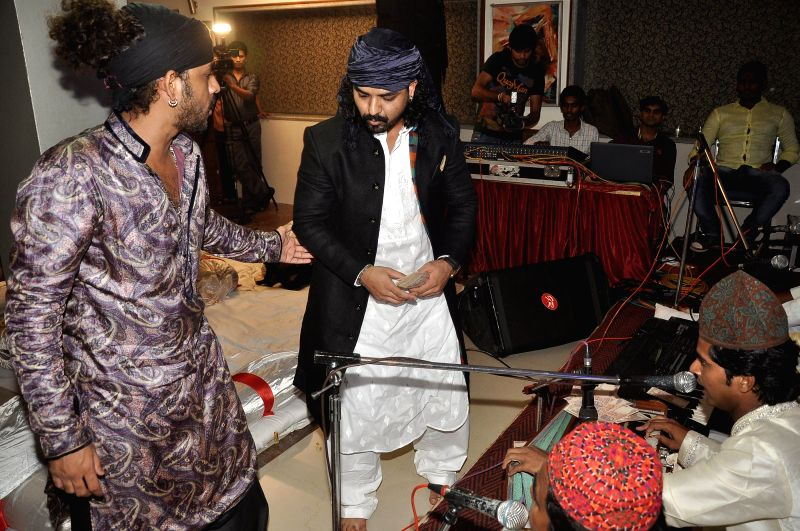 Singers Toshi Sabri and Sharib Sabri during the Toshi's Iftaar party and Sufi Mehfil in Mumbai on July 18, 2014.