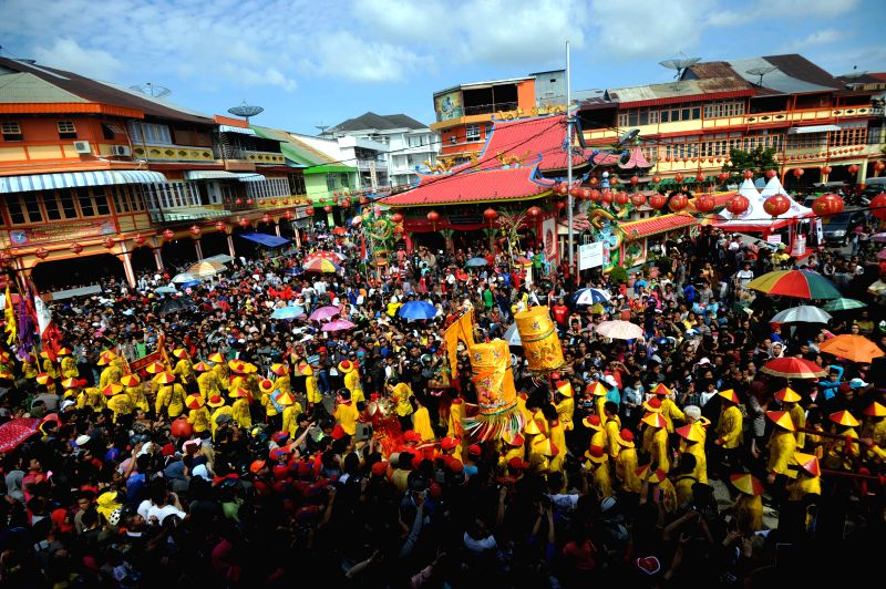 People watch the celebration of Cap Go Meh Festival in Singkawang, Kalimantan, Indonesia, March 5, 2015. The Cap Go Meh Festival, also know as Lantern Festival, ...