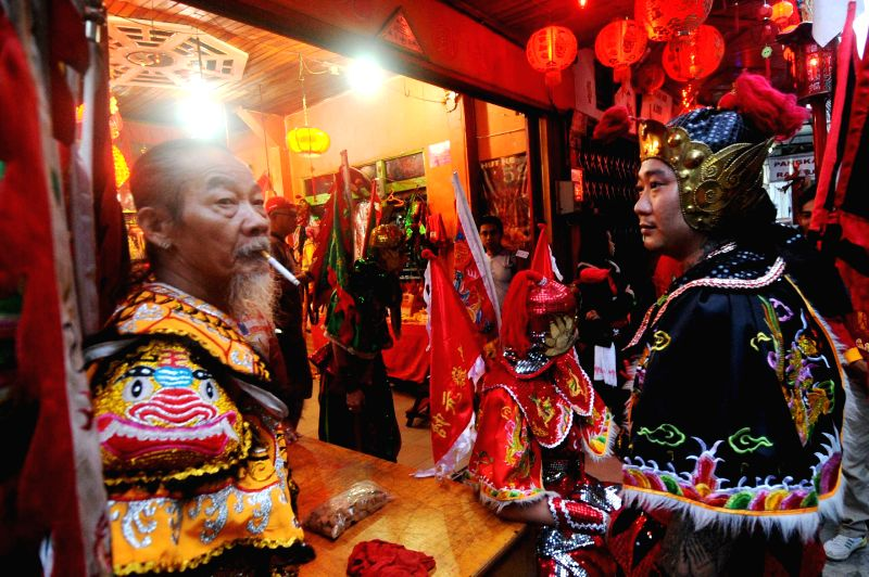 Some Tatung prepare before Cap Go Meh celebrations in Singkawang, Kalimantan, Indonesia, March 5, 2015. The ancient art of Tatung, performed as part of the Cap ...