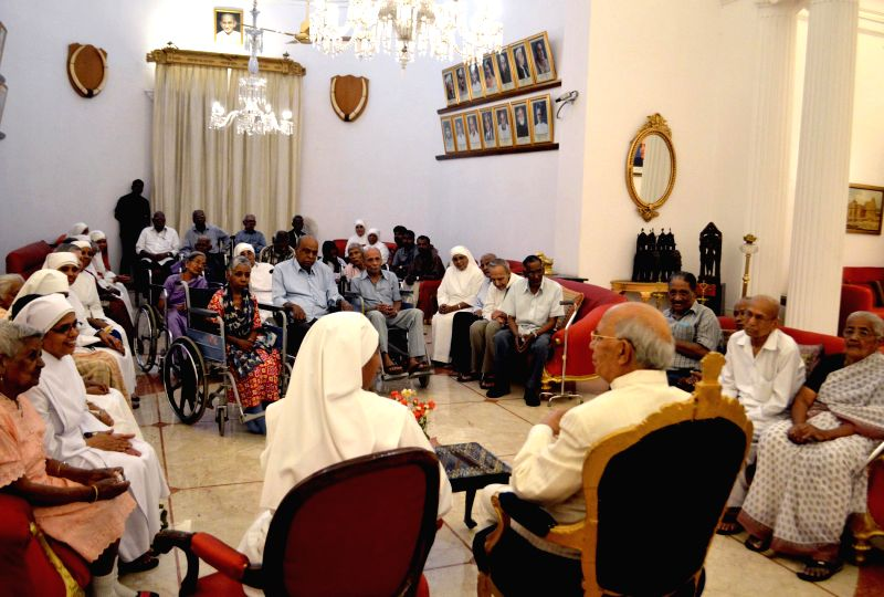 Sisters Michele and Rosemary along with residents of Little Sisters of the Poor meet Karnataka Governor H.R Bharadwaj at Raj Bhavan in Bangalore on May 15, 2014.