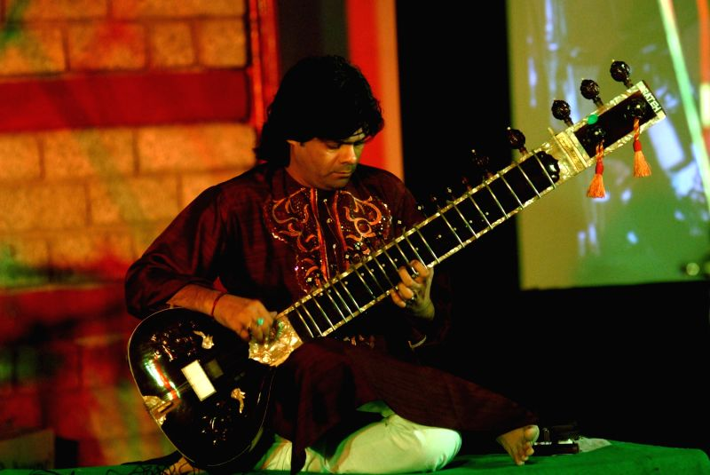 Sitar player Fateh Ali Khan performing at the Rambagh apmhitheatre, Manali.