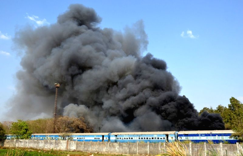 Smoke billows out after a fire broke out in railway coach factory at Nishatpura in Bhopal on April 22, 2017.