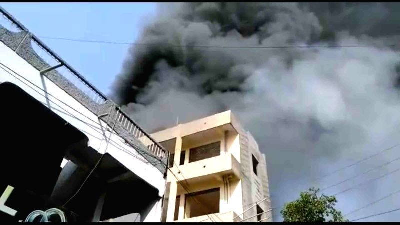 Smoke billows out after a fire broke out in a Mahboobgang market in Hyderabad on May 13, 2017.