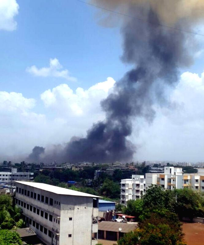 Smoke billows out of a chemical factory in MIDC industrial complex where an explosion took place in a boiler at a private chemical company in Mumbai, on May 26, 2016. At least five workers ...