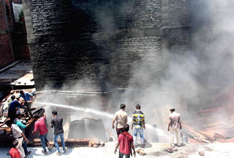 Smoke billows out of a cooler godown where a fire broke out in Bhopal on June 3, 2017.