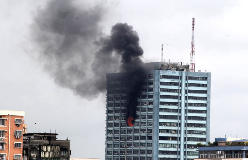 Smoke billows out of Kolkata's landmark Chatterjee International building where a fire broke out on Sept 2, 2014.