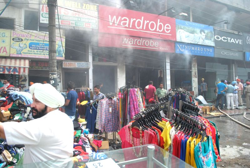 Smoke engulfs a market near Khalsa College where a fire broke out in Amritsar on July 2, 2014.
