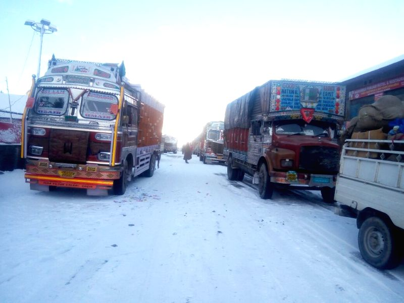 Snowfall leaves trucks stranded in Sonamarg, Jammu and Kashmir on Dec 7, 2017. Night temperatures increased throughout Jammu and Kashmir on Thursday due to a partial overnight cloud cover. ...