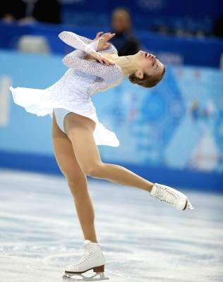 Carolina Kostner of Italy competes during the short program ladies of the figure skating team event at the Sochi 2014 Winter Olympic Games in Sochi, Russia, Feb. 8, ...