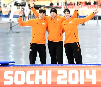 Gold medalist Sven Kramer (C), silver medalist Jan Blokhuijsen (R) and bronze medalist Jorrit Bergsma of the Netherlands pose after the men's 5000m speed skating .