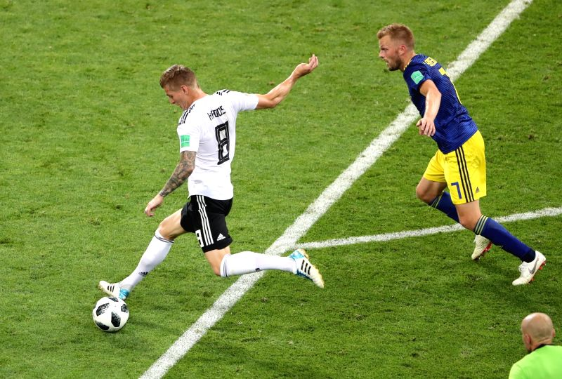 SOCHI, June 23, 2018 - Toni Kroos (L) of Germany shoots during the 2018 FIFA World Cup Group F match between Germany and Sweden in Sochi, Russia, June 23, 2018. Germany won 2-1.