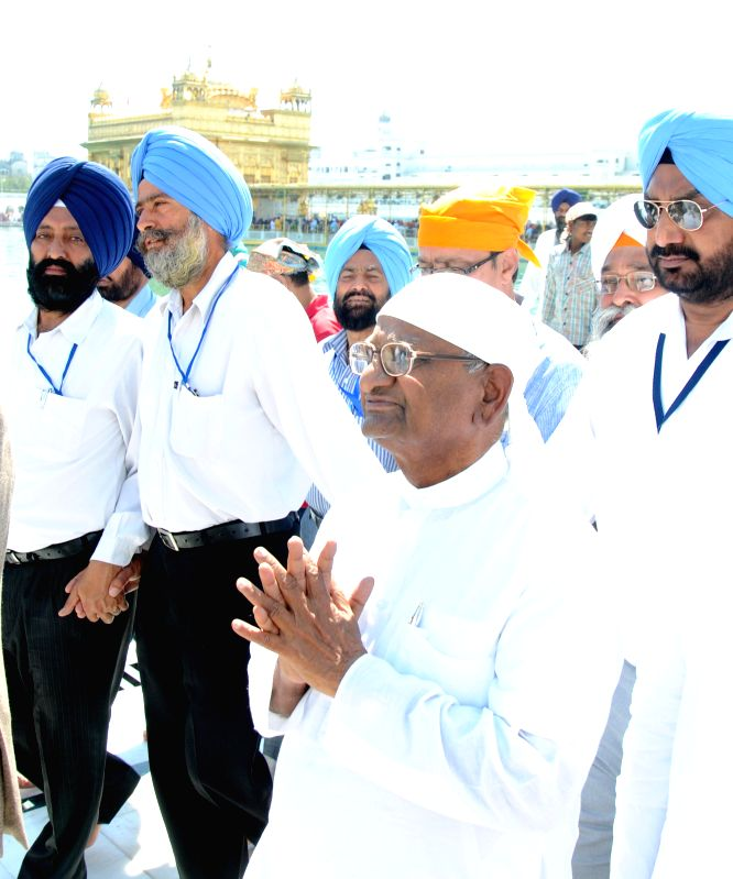 Social activist Anna Hazare pays obeisance at the Golden Temple in Amritsar on March 23, 2015.