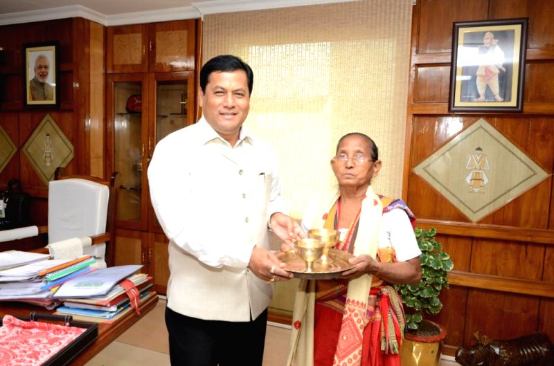 Social activist Birubala Rabha being felicitated by Assam Chief Minister Sarbananda Sonowal in Guwahati on May 21, 2017. She is known for her relentless fight against witch-hunting, - Sarbananda Sonowal