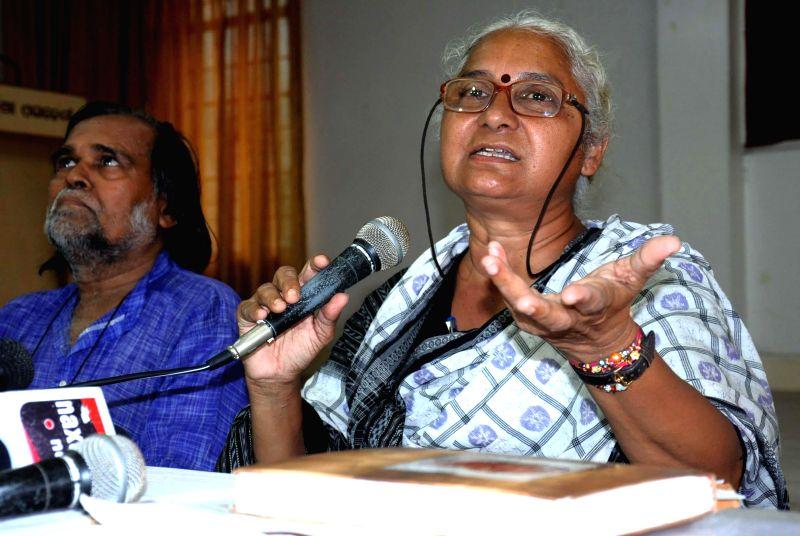 Social activist Medha Patkar addresses a press conference in Bhubaneswar on Aug 26, 2014. (Photo : Arabinda Mahapatra/IANS)