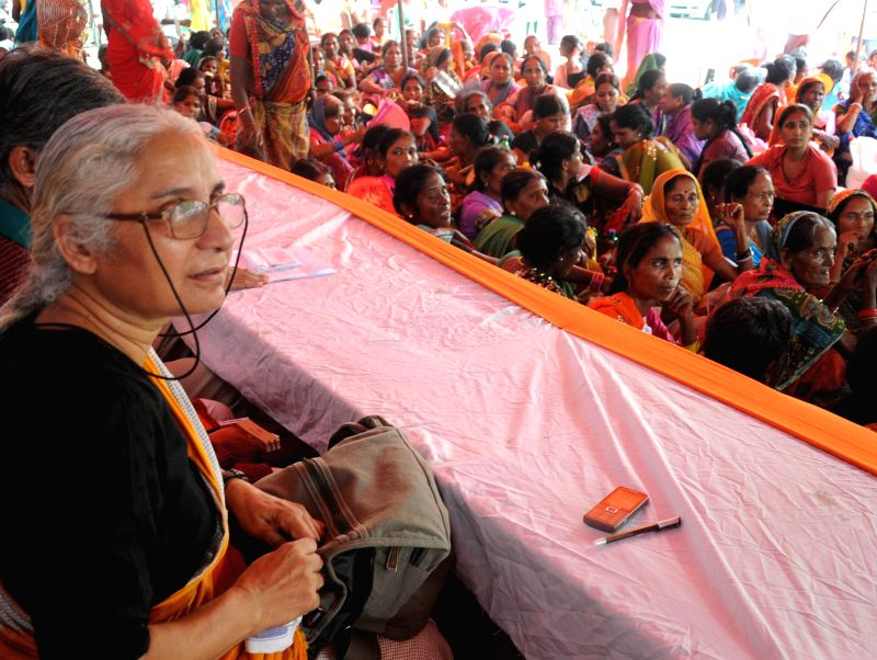 Social activist Medha Patkar participates in a demonstration staged by People from Gujarat, Jharkhand, Chhattisgarh, Delhi, West Bengal and Uttar Pradesh  to press for implementation of National Food