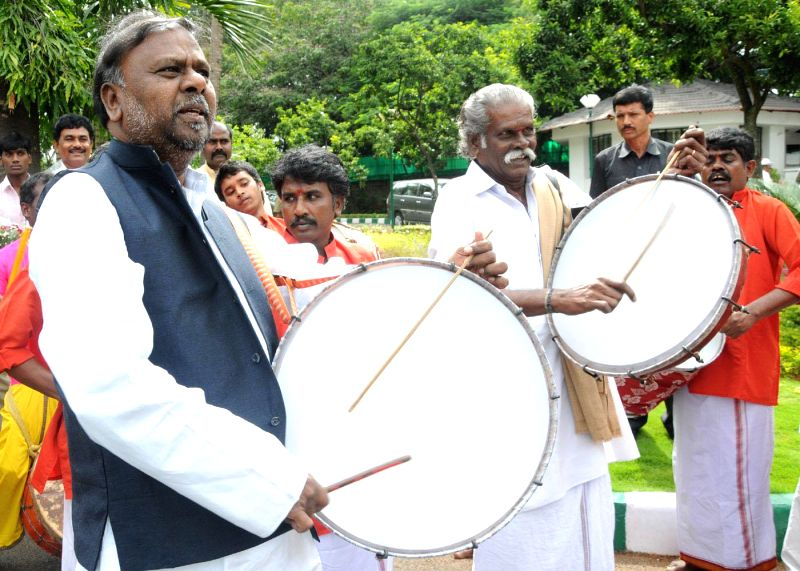 Social Welfare Minister H Anjaneya beats drums with the artists who have been selected to participate in AKKA festival, in United States of America in Bangalore on Aug 28, 2014. - H Anjaneya