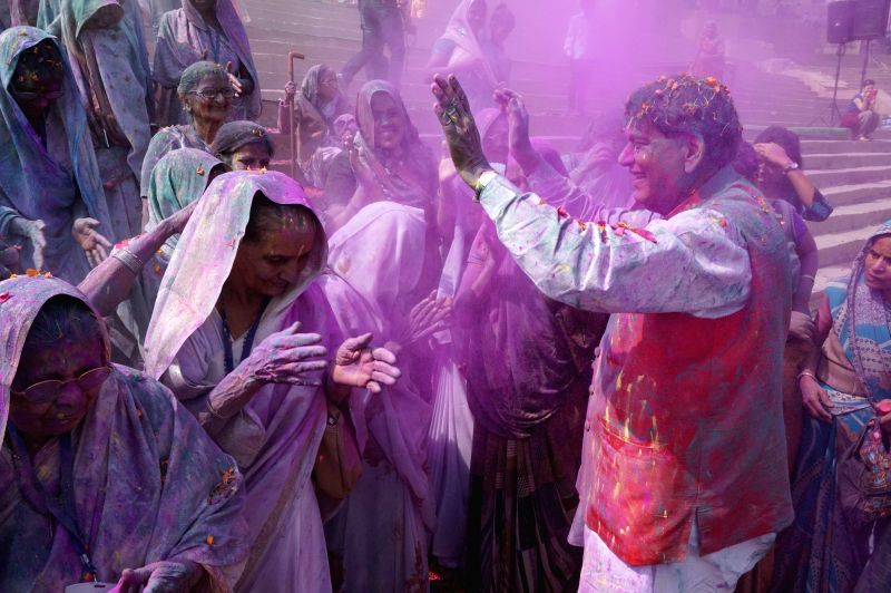 Social worker and Sulabh International founder Bindeshwar Pathak celebrates holi with the widows on the banks of the Ganga river at Assi Ghat of Varanasi on Feb 20, 2015. - Bindeshwar Pathak