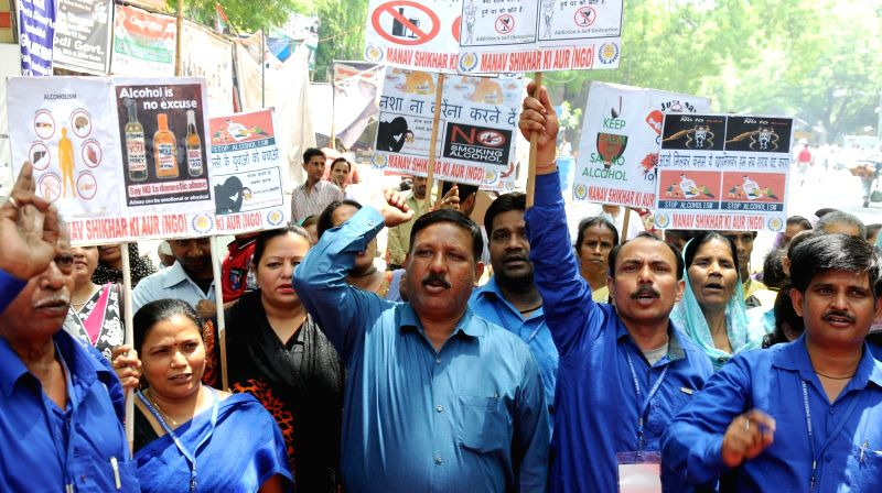 Social workers stage a demonstration to press for liquor free Delhi at Jantar Mantar in New Delhi, on May 15, 2016.