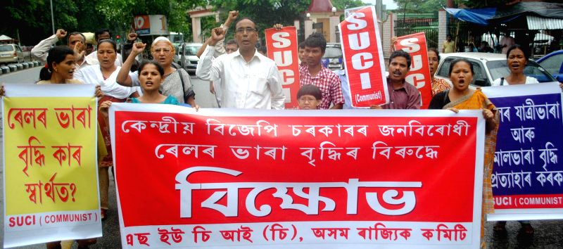 Socialist Unity Centre of India (Communist) activists demonstrate against rail tariff hike in Guwahati on June 23, 2014.