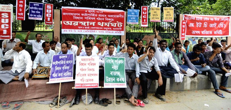 Socialist Unity Centre of India (Communist) activists demonstrate against hike in prices of essential commodities in Guwahati on July 4, 2014.