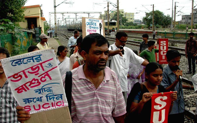 Socialist Unity Centre of India (SUCI) activists demonstrate against rail tariff hike at Dum Dum railway station in Kolkata on June 25, 2014.