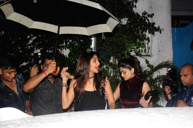 Socialite Anu Dewan, Bollywood actors Shilpa Shetty and Shamita Shetty spotted at a restaurant in Bandra, in Mumbai, on July 28, 2016. - Shilpa Shetty and Shamita Shetty