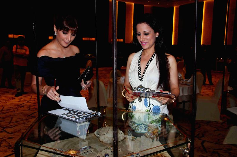Socialite Michelle Poonawala and painter Rouble Nagi during the jury meets for the 10th annual Gemfields and Nazraana Retail Jeweller India Awards 2014 at Hotel Sahara Star in Mumbai on July 3, 2014.