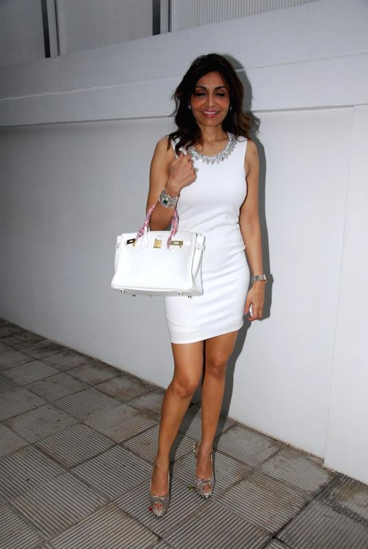 Socialite Queenie Singh during the birthday celebration of artist Rouble Nagi in Mumbai on July 7, 2014. - Queenie Singh