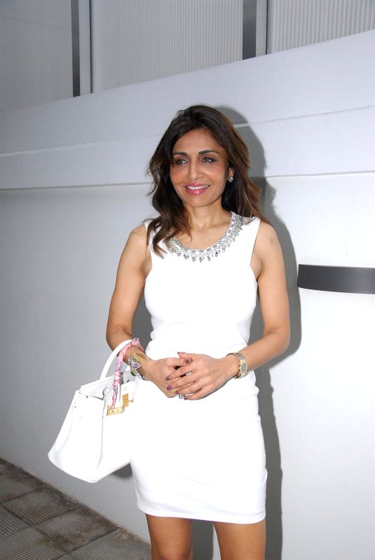 Socialite Queenie Singh during the birthday celebration of artist Rouble Nagi in Mumbai on July 7, 2014. - Queenie Singh