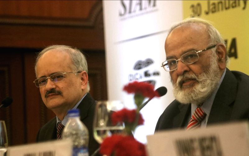 Society of Indian Automobile Manufacturers (SIAM) President and Force Motors Chairman Abhay Firodia (R) addresses a press conference regarding 14th Auto Expo 2018, in New Delhi on Jan 30, ...