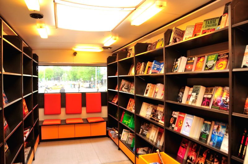 "Photo taken on April 23, 2014 shows a ""mobile bookstore"" in Sofia, Bulgaria. People set up a bookstore in a bus to mark the World Book Day in Sofia. The ..."