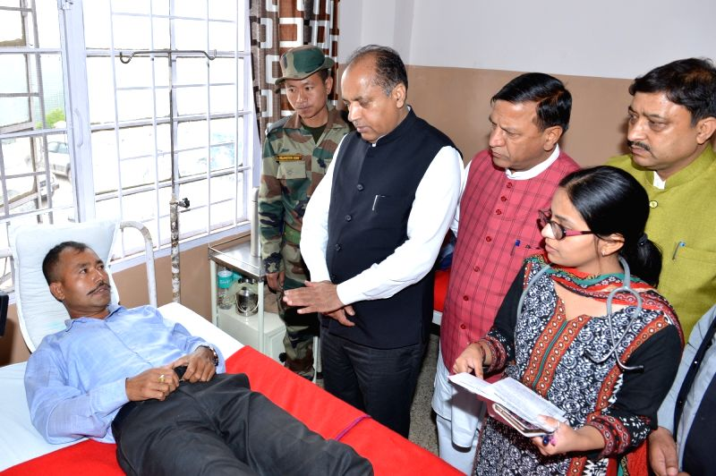 Solan: Himachal Pradesh Chief Minister Jai Ram Thakur meets one of the victims of a building collapse, receiving treatment at a hospital in Solan district on July 15, 2019. Eleven soldiers and a civilian were killed and 28 others rescued after a four
