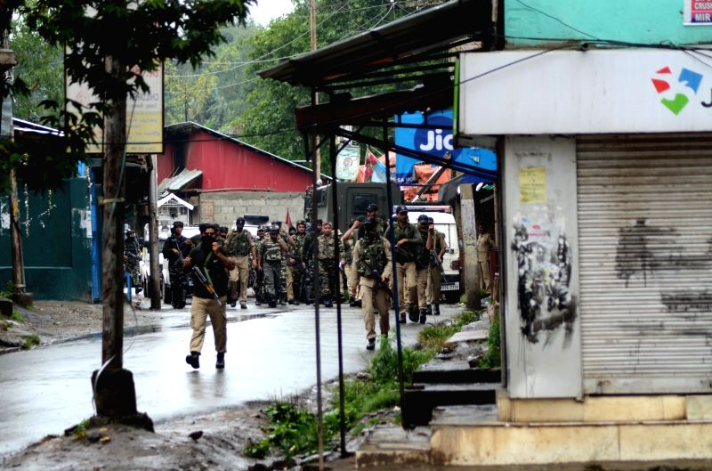 :Soldiers at the site where a group of militants fired upon a CRPF patrol party at Achabal chowk killing two CRPF personnel in Jammu and Kashmir's Anantnag district on July 13, 2018. (Photo: ...