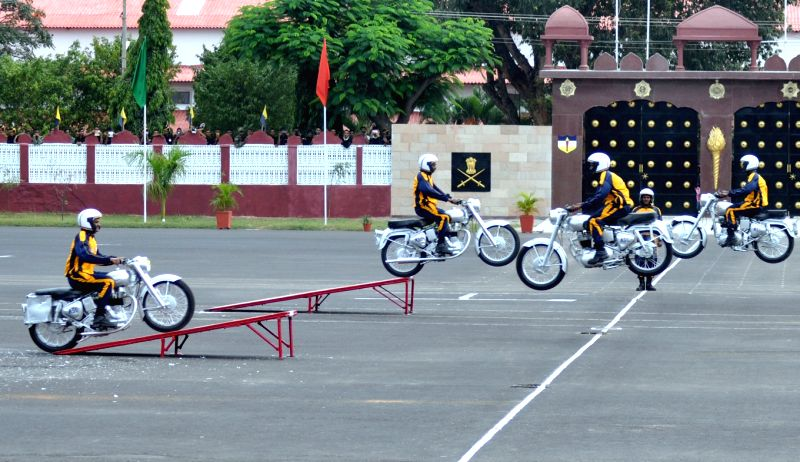 Soldiers display their skills during the 10th Reunion and 255th Anniversary of Army Service Corps at Indian Army ASC Centre and College, in Bengaluru on Dec 8, 2015.