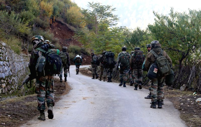 Soldiers during an encounter with militants in Bandipora forests of Jammu and Kashmir on Oct 29, 2015.