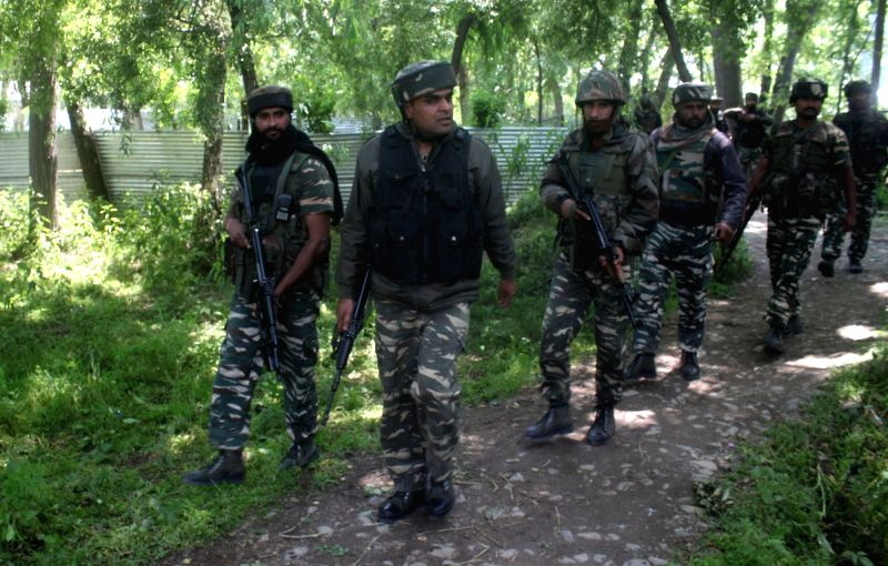 Soldiers during an encounter with militants in Pulwama on May 27, 2017. Hizbul Mujahideen commander, Sabzar Bhat who succeeded slain militant, leader Burhan Wani, was killed along with ...