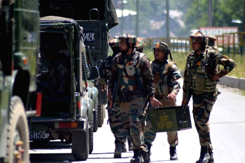 Soldiers in action during an encounter with militants in Kunzar Tangmarg area of Jammu and Kashmir's Baramulla district on May 27, 2016.