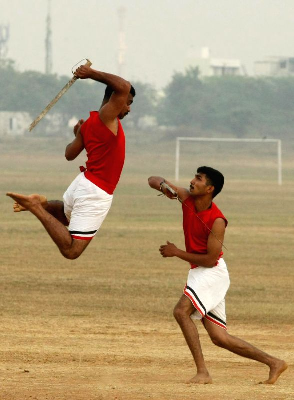 Soldiers of the Madras Regiment perform Kalaripayattu - martial arts of South India during the Combined display - a prelude to the Passing Out Parade - organised at Officers Training Academy (OTA), ...