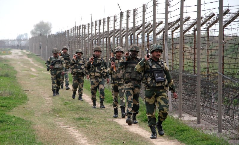 Soldiers patrol along the Indo-Pak border fence in RS Pora Sector of Jammu and Kashmir on May 2, 2017.